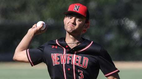 Newfield pitcher Dylan Johnson delivers to the plate