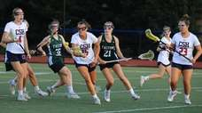 Cold Spring Harbor's Anna Spehr gathers the ball