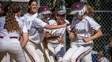 Bay Shore's Julia Carpenter, right, is greeted at