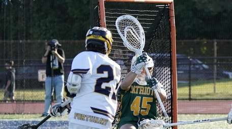 Northport's Casey Fortunato (27) shoots and scores against