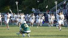 Northport boys lacrosse team rush their goalie after