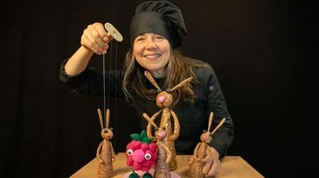 Pupeteer Liz Joyce with marzipan puppets at her
