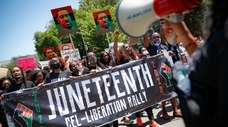 A Juneteenth rally at the Brooklyn Museum on