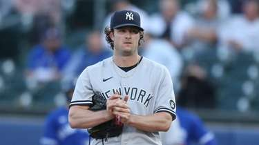 Gerrit Cole #45 of the Yankees rubs the