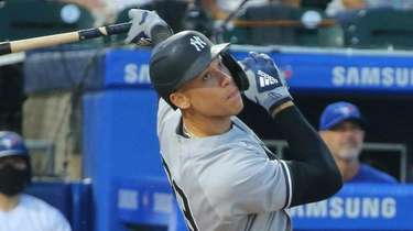 Yankees' Aaron Judge hits a foul ball during