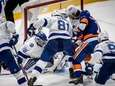 New York Islanders' #15 Cal Clutterbuck scoring on