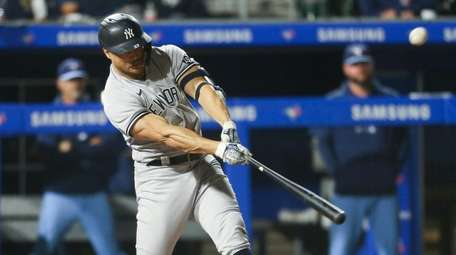 Giancarlo Stanton #27 of the Yankees hits a