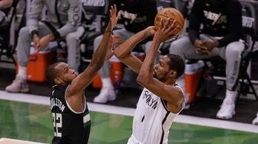 Nets' Kevin Durant shoots against Milwaukee Bucks forward