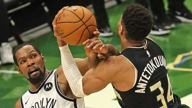 Kevin Durant #7 of the Brooklyn Nets fouls