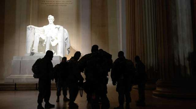 A group visits the Lincoln Memorial in Washington,