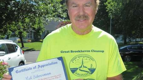 Mel Silverman holds a certificate of appreciation from