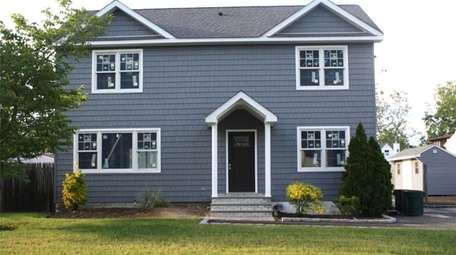 Priced at $519,000, this three-bedroom, two-bathroom Colonial in