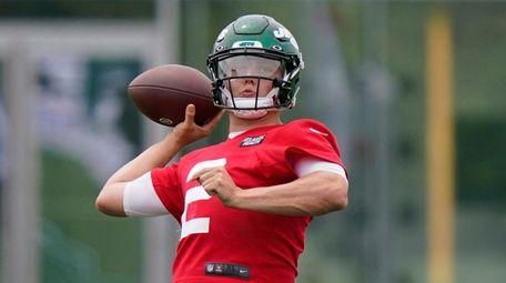 Jets quarterback Zach Wilson drops back for a