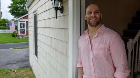 Charles Weinraub at his rental property in Patchogue