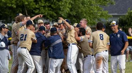 Bethpage's celebrates their victory over Plainedge in game