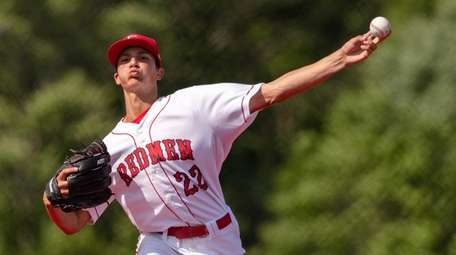 Nick Rizzo of East Islip throws to the