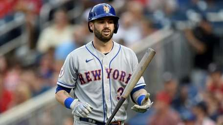 Tomas Nido #3 of the Mets reacts after