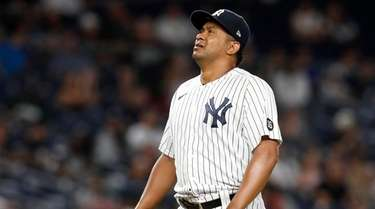 Wandy Peralta #58 of the Yankees reacts on