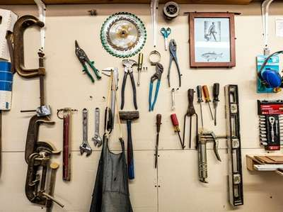 An array of tools hangs on the wall