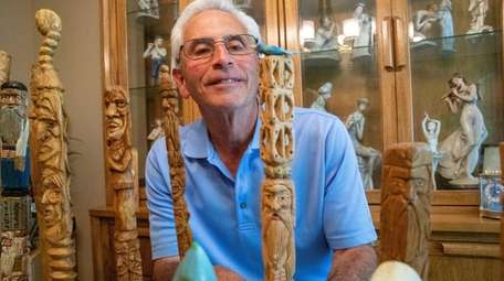 Art Kleiner with his father's carved-wood walking sticks.