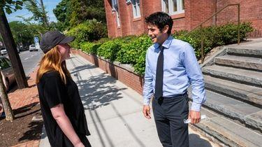 Southampton Village Mayor Jesse Warren, right, chats with
