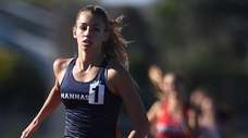 Angeline Caamano of Manhasset legs out a victory