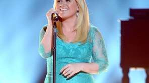 Kelly Clarkson performs during the 48th annual Academy