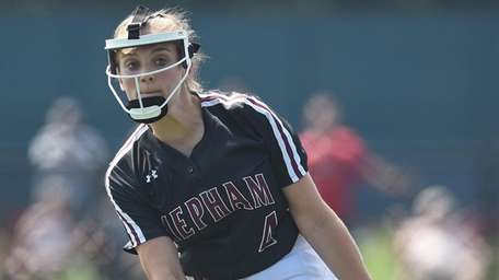 Giselle DeLutri #4, Mepham pitcher, delivers to the