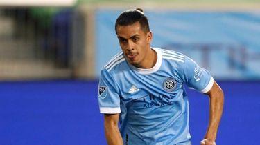 NYCFC forward Jesus Medina works the ball against