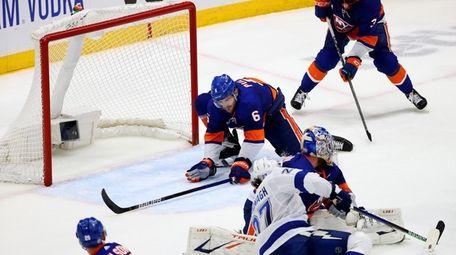Ryan Pulock #6 of the Islanders blocks a