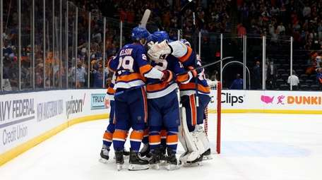 The New York Islanders celebrate after their 3-2