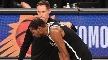 Nets head coach Steve Nash consoles Kevin Durant