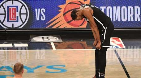 Brooklyn Nets forward Kevin Durant reacts as the