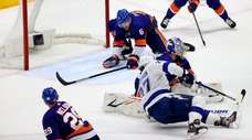 Ryan Pulock of the Islanders blocks a shot