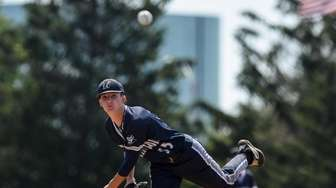 Huntington starting pitcher, Palmer O'Beirne throws to the