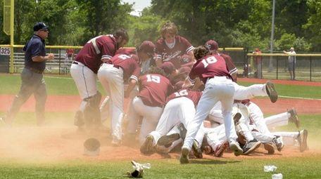 Garden City celebrates after winning the Long Island
