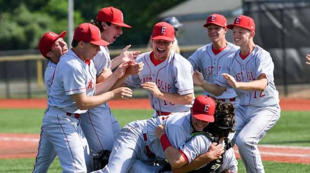 East Islip players celebrate after winning the Long