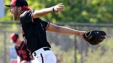 Newfield pitcher Dylan Johnson reacts after the final