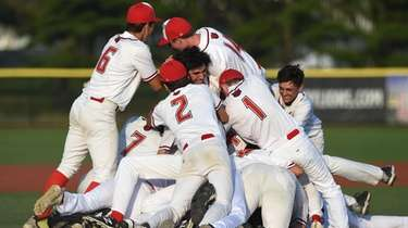 Wheatley teammates celebrate after their 10-3 win over