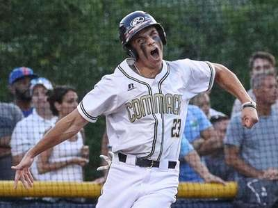 Johnny Catuosco of Commack crosses the plate to