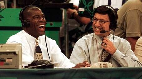 Magic Johnson, left, shares a laugh with Marv
