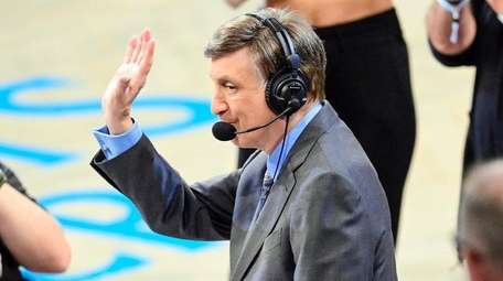 Sportscaster Marv Albert is honored during a timeout