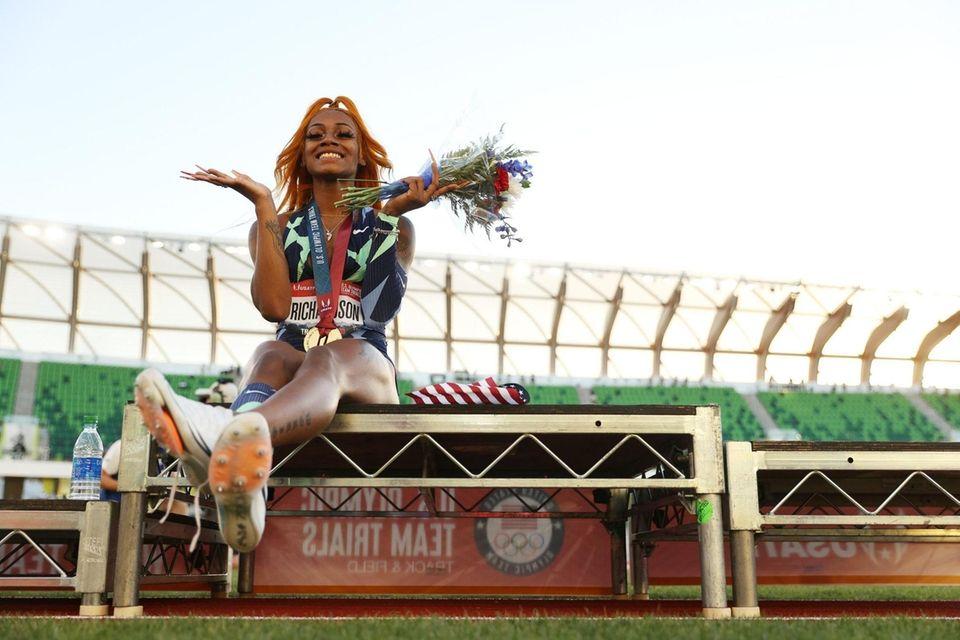 Sha'Carri Richardson celebrates winning the Women's 100 Meter