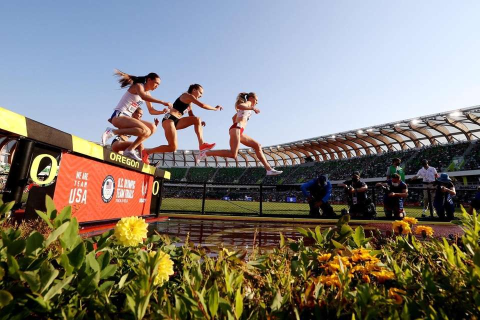 EUGENE, OREGON - JUNE 20: Runners compete in