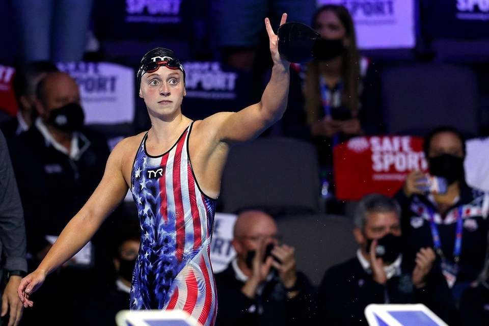 Katie Ledecky of the United States reacts after