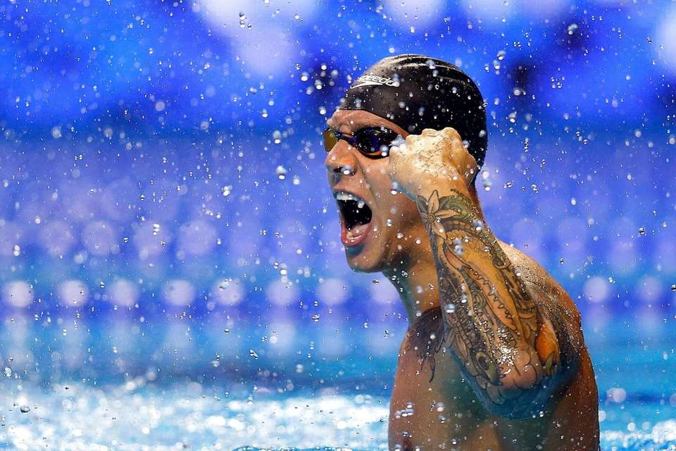 Caeleb Dressel of the United States reacts after