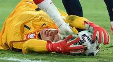 Poland's goalkeeper Wojciech Szczesny tries to grab the