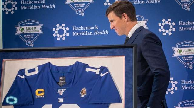 Eli Manning after speaking during his retirement press