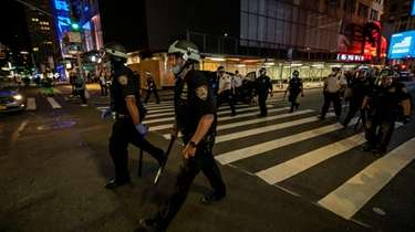 NYPD officers patrol the streets of Manhattan on