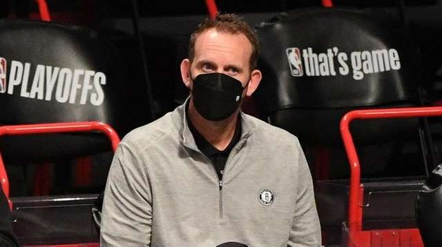 Nets general manager Sean Marks, right, watches warmups